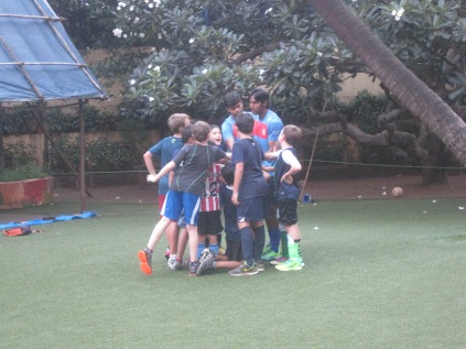 Kicking it on whatever pitch we can - the DB's school currently rocks a coconut tree in the middle of the pitch.